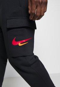Nike Sportswear - PANT CARGO - Pantalon de survêtement - black - 4