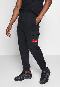 Nike Sportswear - PANT CARGO - Pantalon de survêtement - black - 0