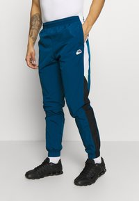 Nike Sportswear - PANT SIGNATURE - Trainingsbroek - blue force/black/white - 0