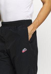 Nike Sportswear - PANT SIGNATURE - Spodnie treningowe - black - 4