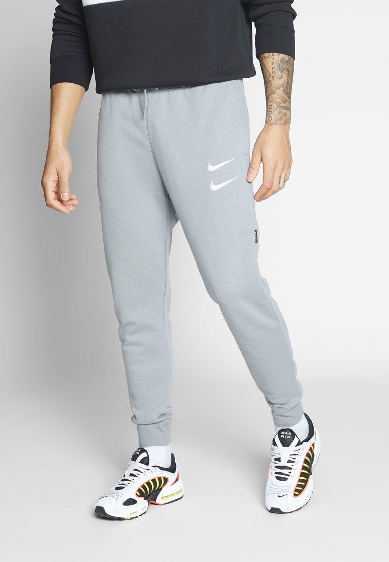 Nike Sportswear - M NSW PANT FT - Pantalon de survêtement - particle grey