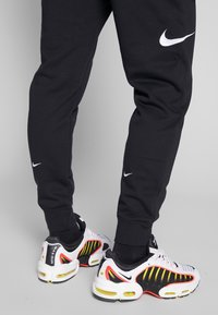 Nike Sportswear - M NSW PANT FT - Tracksuit bottoms - black/white - 4