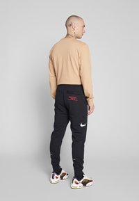 Nike Sportswear - M NSW PANT FT - Tracksuit bottoms - black/white - 2