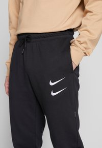 Nike Sportswear - M NSW PANT FT - Tracksuit bottoms - black/white - 3