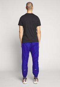 Nike Sportswear - Verryttelyhousut - deep royal blue/white - 2
