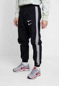 Nike Sportswear - Verryttelyhousut - black/particle grey/white - 0