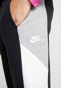 Nike Sportswear - Tracksuit bottoms - black/grey/white - 4