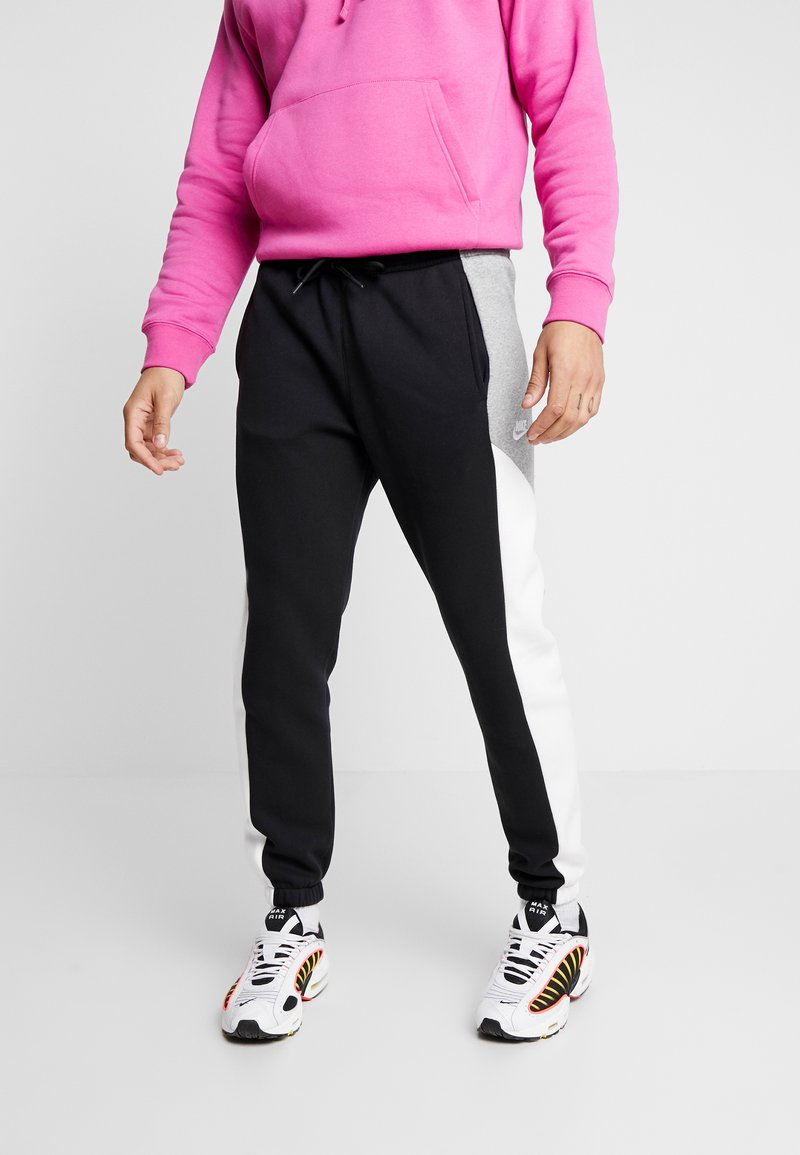 Nike Sportswear - Tracksuit bottoms - black/grey/white