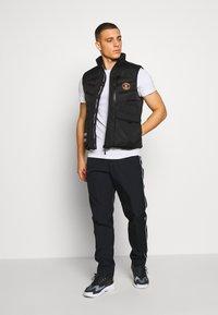 Nike Sportswear - PANT - Verryttelyhousut - black - 1