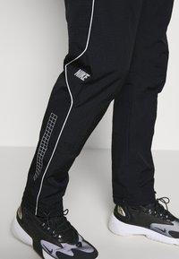 Nike Sportswear - PANT - Verryttelyhousut - black - 3