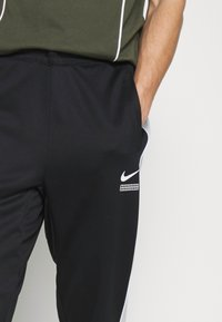 Nike Sportswear - PANT - Tracksuit bottoms - black/light smoke grey/white - 4