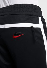 Nike Sportswear - M NSW NIKE AIR PANT PK - Verryttelyhousut - black/white - 5