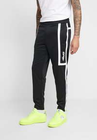 Nike Sportswear - M NSW NIKE AIR PANT PK - Verryttelyhousut - black/white - 0