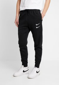 Nike Sportswear - Tracksuit bottoms - black/white - 0