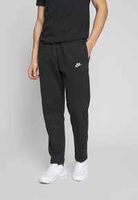 Nike Sportswear - CLUB PANT - Tracksuit bottoms - black/white - 0