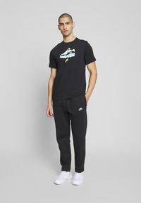 Nike Sportswear - CLUB PANT - Tracksuit bottoms - black/white - 1