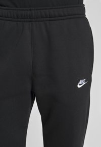 Nike Sportswear - CLUB PANT - Tracksuit bottoms - black/white - 4