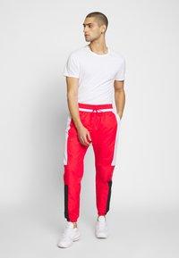 Nike Sportswear - AIR - Spodnie treningowe - university red/white/black - 1