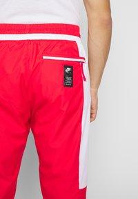 Nike Sportswear - AIR - Spodnie treningowe - university red/white/black - 3