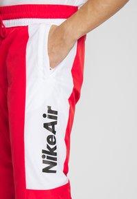 Nike Sportswear - AIR - Spodnie treningowe - university red/white/black - 5