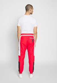 Nike Sportswear - AIR - Spodnie treningowe - university red/white/black - 2