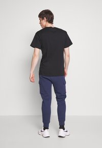 Nike Sportswear - Tracksuit bottoms - midnight navy - 2