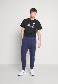 Nike Sportswear - Tracksuit bottoms - midnight navy - 1