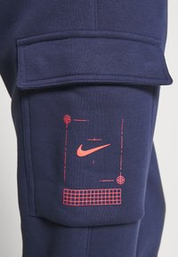 Nike Sportswear - Tracksuit bottoms - midnight navy - 5
