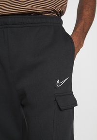 Nike Sportswear - Tracksuit bottoms - black - 4