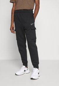 Nike Sportswear - Spodnie treningowe - black - 0