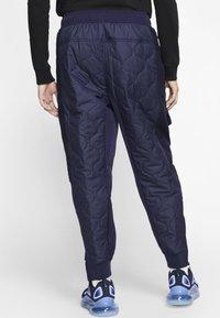 Nike Sportswear - Tracksuit bottoms - blackened blue/mystic green/black - 2