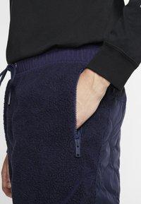 Nike Sportswear - Tracksuit bottoms - blackened blue/mystic green/black - 3
