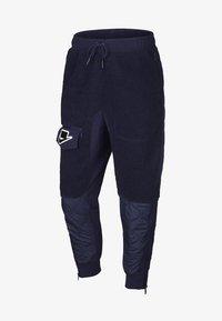 Nike Sportswear - Tracksuit bottoms - blackened blue/mystic green/black - 7