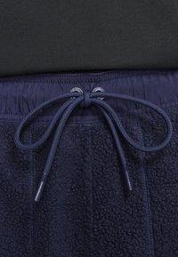 Nike Sportswear - Tracksuit bottoms - blackened blue/mystic green/black - 6