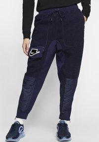 Nike Sportswear - Tracksuit bottoms - blackened blue/mystic green/black - 0