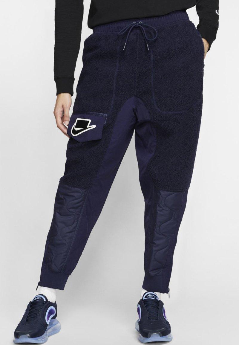 Nike Sportswear - Tracksuit bottoms - blackened blue/mystic green/black