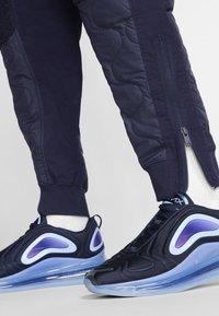 Nike Sportswear - Tracksuit bottoms - blackened blue/mystic green/black - 5