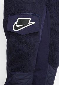 Nike Sportswear - Tracksuit bottoms - blackened blue/mystic green/black - 4