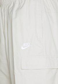 Nike Sportswear - PANT PLAYERS - Spodnie treningowe - light bone - 3