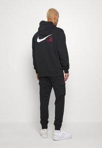 Nike Sportswear - Tracksuit bottoms - black - 2