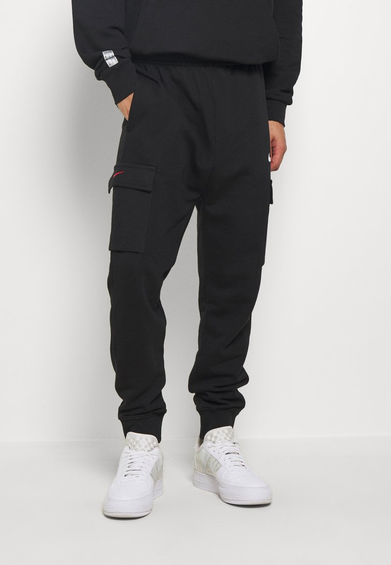 Nike Sportswear - Tracksuit bottoms - black