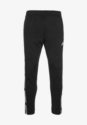 JUST DO IT TAPE  - Tracksuit bottoms - black