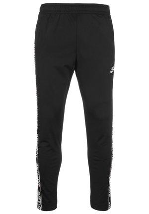JUST DO IT TAPE  - Pantalon de survêtement - black