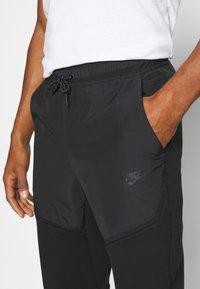 Nike Sportswear - Pantalones deportivos - black - 4