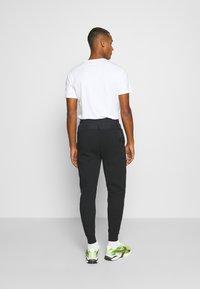 Nike Sportswear - Pantalones deportivos - black - 2