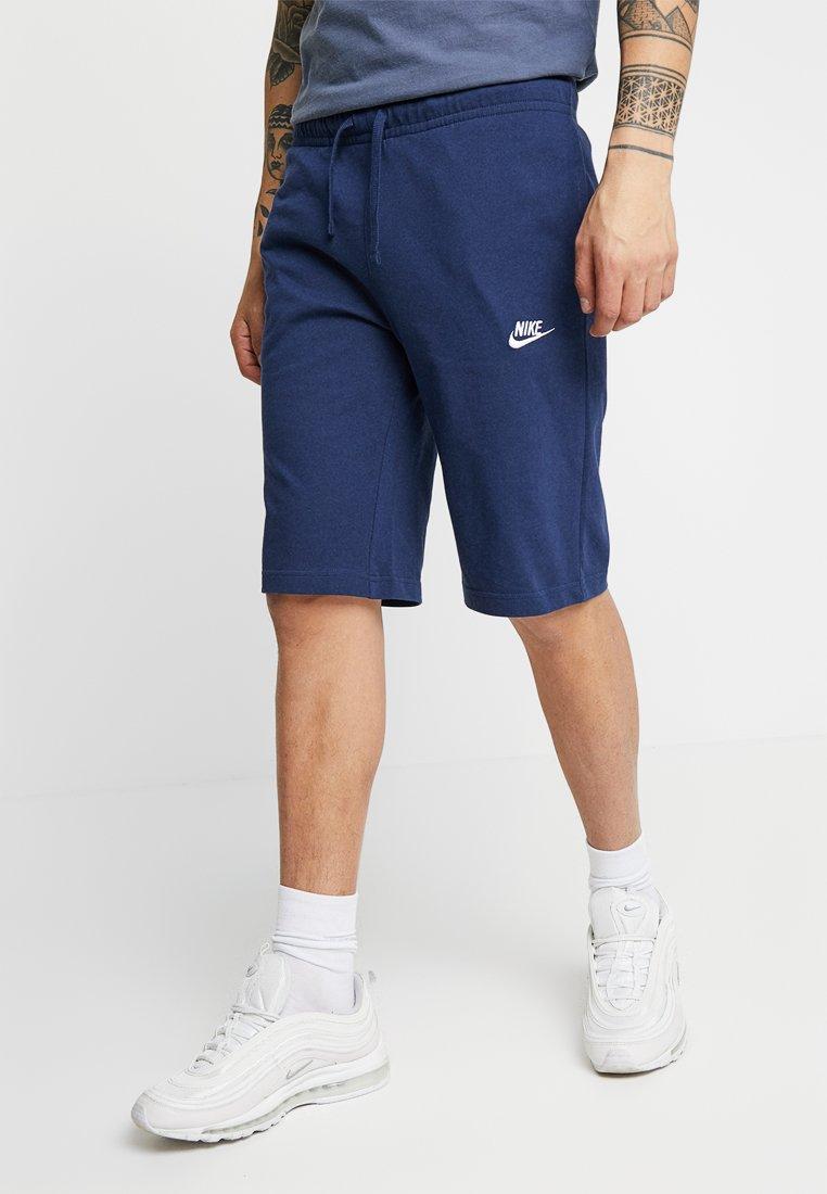 Nike Sportswear - CLUB - Tracksuit bottoms - midnight navy/white