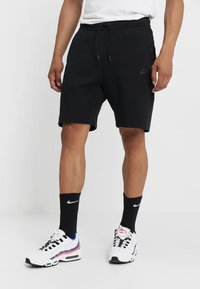 Nike Sportswear - TCH FLC - Pantalones deportivos - black - 0