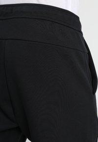 Nike Sportswear - TCH FLC - Pantalones deportivos - black - 5