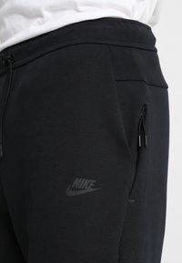 Nike Sportswear - TCH FLC - Pantalones deportivos - black - 3
