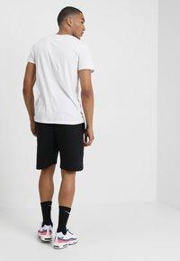Nike Sportswear - TCH FLC - Pantalones deportivos - black - 2